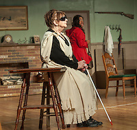 """Jane Adams/Saphaedra Renee tries to flee as she is greeted by Olive/Evelyn Taylor at the Ye Olde Wayside Inn during dress rehearsal for """"It Was a Dark and Stormy Night"""" with the Streetcar Company on Tuesday evening at Laconia High School's auditorium.  (Karen Bobotas/for the Laconia Daily Sun)"""