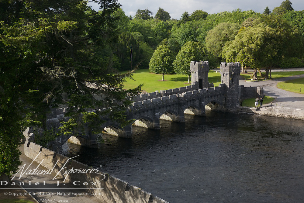 A couple of fisherman prepare to try their luck on the river next to the Ashford Castle, Ireland.