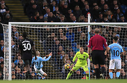 Manchester City's David Silva scores his side's second goal of the game