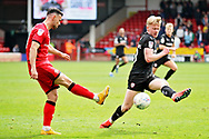 Barnsley defender Ben Williams (28) blocks this clearance from Walsall FC midfielder Zeli Ismail (10) during the EFL Sky Bet League 1 match between Walsall and Barnsley at the Banks's Stadium, Walsall, England on 23 March 2019.