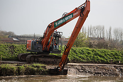 LNP HIGHLIGHTS OF THE WEEK 04/04/14 ©  London News Pictures. 31/03/2014. Burrowbridge, UK. Dredging starts on a stretch of the River Parrett between Burrowbridge and Moorland in Somerset. Dredging on the Somerset Levels has started as part of a package of measures aimed at preventing a repeat of the winter floods. Work is beginning on five miles (8km) of the rivers Parrett and Tone. Other measures recommended in a £100m, 20-year Flood Action Plan include a tidal barrage and extra pumping sites. Photo credit: Ed Stone/LNP