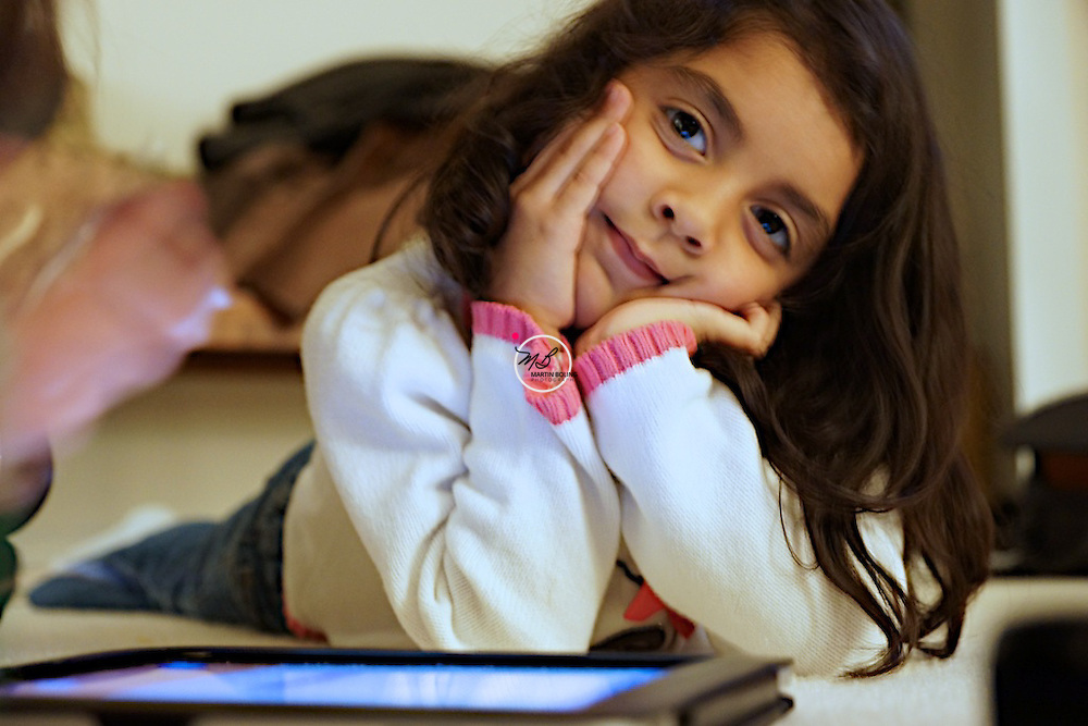 Young girl day dreams of her own iPad