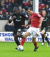 Photo: Dave Linney.<br />Walsall v Milton Keynes Dons. Coca Cola League 1.<br />08/10/2005.Ruben Dario Larrosa charges past Nicky<br />Rizzo/MK Dons