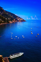 """A view from Positano to Praiano of the blue skies reflected in the Mediterranean Sea""...<br />