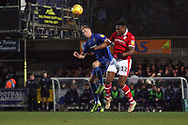 AFC Wimbledon midfielder Mitchell (Mitch) Pinnock (11) battles for possession with Barnsley defender Dimitri Cavare (12) during the EFL Sky Bet League 1 match between AFC Wimbledon and Barnsley at the Cherry Red Records Stadium, Kingston, England on 19 January 2019.