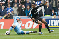 Photo: Steve Bond/Richard Lane Photography.<br />Coventry City v Chelsea. FA Cup 6th Round. 07/03/2009. Aron Gunnarsson (L) slides in on Jon obi Mikel