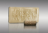 Hittite cylinder seal depicting a scene of animals, seal in foreground and impression standing behind.. Adana Archaeology Museum, Turkey. Against a grey background .<br /> <br /> If you prefer to buy from our ALAMY STOCK LIBRARY page at https://www.alamy.com/portfolio/paul-williams-funkystock/hittite-art-antiquities.html . Type - Adana - in LOWER SEARCH WITHIN GALLERY box. Refine search by adding background colour, place, museum etc.<br /> <br /> Visit our HITTITE PHOTO COLLECTIONS for more photos to download or buy as wall art prints https://funkystock.photoshelter.com/gallery-collection/The-Hittites-Art-Artefacts-Antiquities-Historic-Sites-Pictures-Images-of/C0000NUBSMhSc3Oo