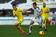 Jason Davidson of Huddersfield Town (r) gets away from Lewis Cook of Leeds united. Skybet football league Championship match, Huddersfield Town v Leeds United at the John Smith's Stadium in Huddersfield, Yorks on Saturday 7th November 2015.<br /> pic by Chris Stading, Andrew Orchard sports photography.