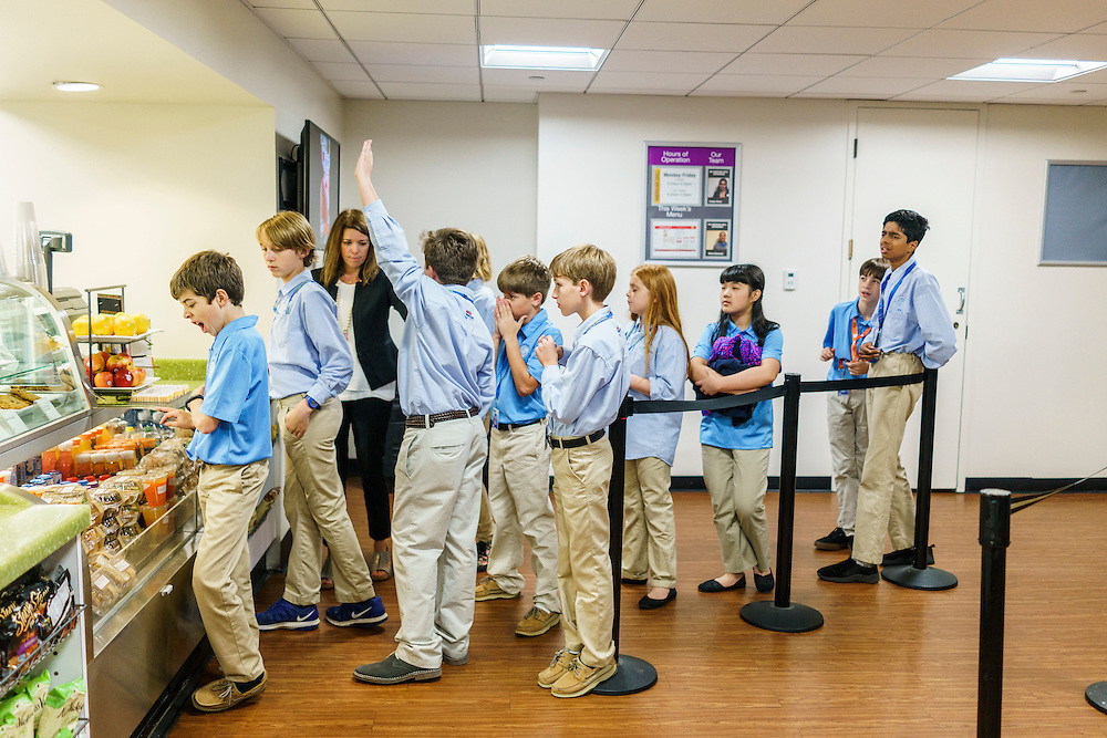 Washington, D.C. - October 07, 2016: Members of the Hyperbolics line up inside the Dirksen Senate Office Building cafeteria to order lunch before their second meeting of the day. <br /> <br /> The Hyperbolics are a First Lego League team based out of Sterling School in Greenville SC, who made a trip to DC ask government officials to ban lead wheel weights Friday October 7, 2016.<br /> <br /> <br /> CREDIT: Matt Roth for Earthjustice