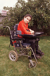 Portrait of teenage girl with cerebral palsy outside in garden,