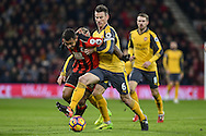 AFC Bournemouth Midfielder, Joshua King (17) and Arsenal Defender, Laurent Koscielny (6) battle for the ball during the Premier League match between Bournemouth and Arsenal at the Vitality Stadium, Bournemouth, England on 3 January 2017. Photo by Adam Rivers.