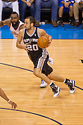 June 2, 2012; Oklahoma City, OK, USA; San Antonio Spurs guard Manu Ginobili (20) dribbles the ball during a playoff game against the Oklahoma City Thunder  at Chesapeake Energy Arena.  Thunder defeated the Spurs 109-103 Mandatory Credit: Beth Hall-US PRESSWIRE