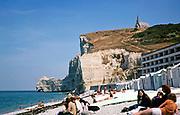 La Falaise d'Amont chalk headland with Chapelle Notre-Dame-de-la-Garde church, Etretat beach,  Normandy, France 1976