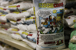 Specially packaged sugar containing cartoons and articles from the Venezuelan constitution are on display at Mercal, a government sponsored subsidized food market, in the poor slum of Catia.  The Chavez government has built many of these markets throughout Venezuela.  It is one of the many social programs that Chavez saysaids the poor. Opponents claim that these programs  are not sustainable and are really aimed at gaining support for Chavez.