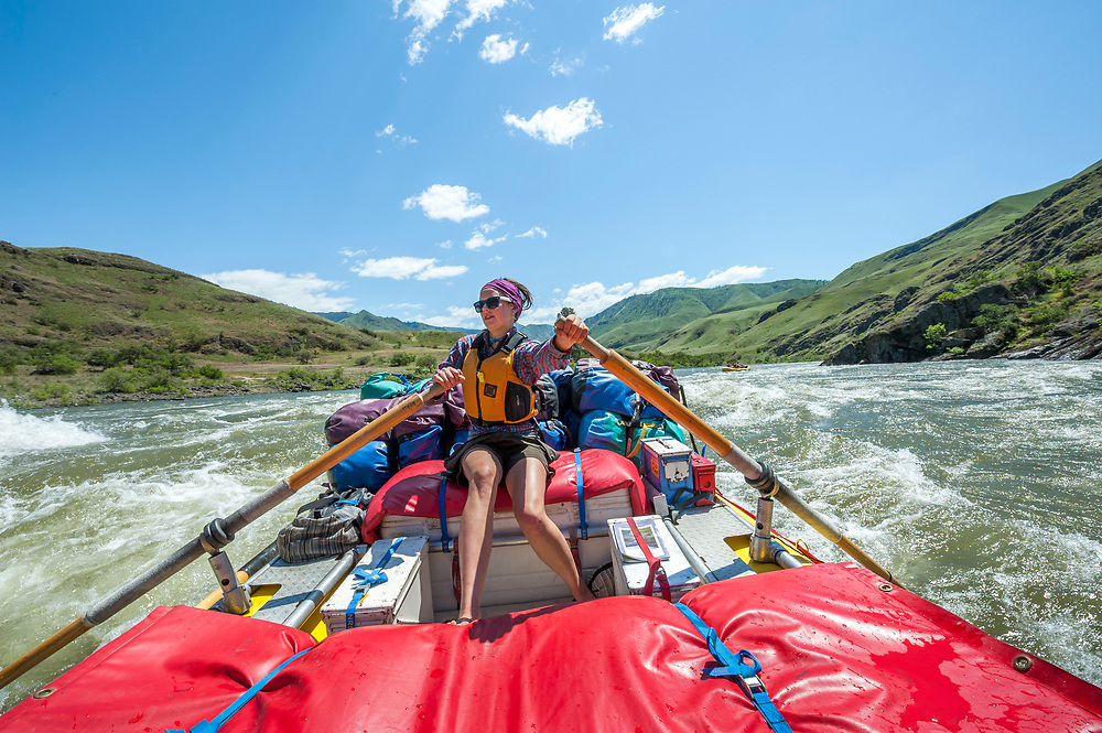 Keegan maneuvers the gear boat through some active water on the Snake River in Hells Canyon.  Open Edition Prints and Editorial Usage Only.