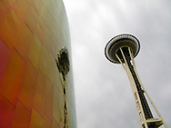 Space Needle and its reflection on the Experience Music Project shingled wall, Seattle Center, Seattle, Washington, USA