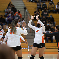 The Gallup Bengals celebrate after winning a point against the Miyamura Patriots at Gallup High School Thursday night in Gallup. The Gallup Bengals had a 22-25, 25-23, 25-22, 25-14 victory over the Miyamura Patriots.