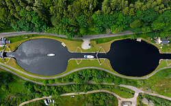 Crinan, Scotland, UK. 28 June 2021. Aerial view of flight of locks on the Crinan Canal in Argyll & Bute. Low rainfall for several months and a relatively dry winter means that water levels in the canal are low. Restrictions on vessels using the canal might be introduced if dry weather continues through the summer. Iain Masterton/Alamy Live News