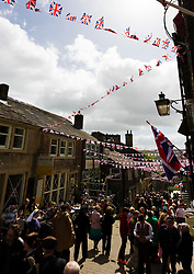 © Paul Thompson licensed to London News Pictures. 16/05/2015. Haworth, West Yorkshire, UK. Haworth High Street during the 1940s weekend, an annual event in which people dress in period costume and visit the village of Haworth to relive the 1940s.  Photo credit : Paul Thompson/LNP
