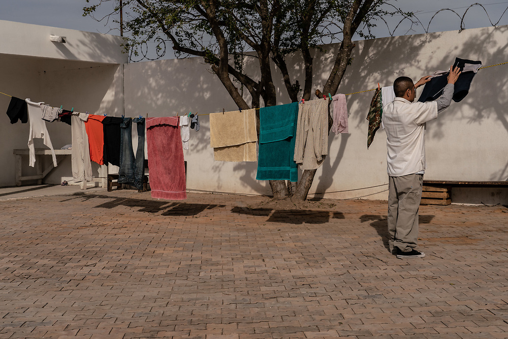 A Mexican migrant who was deported back to Mexico hangs his laundry at Casa del Migrante in Matamoros, Mexico January 25, 2019.