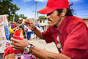 """10 JANUARY 2007 - MANAGUA, NICARAGUA: A vender sells raspados (fruit flavored iced treats) to Sandanista supporters arriving in Managua to participate in the inauguration of Daniel Ortega Wednesday. Ortega, the leader of the Sandanista Front, was sworn in as the President of Nicaragua Wednesday. Ortega and the Sandanistas ruled Nicaragua from their victory of """"Tacho"""" Somoza in 1979 until their defeat by Violetta Chamorro in the 1990 election.  Photo by Jack Kurtz"""