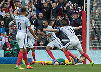 Football - 2016 / 2017 World Cup Qualifier - UEFA Group F: England vs. Lithuania<br /> <br /> Jermain Defoe of England turns away after scoring as Adam Lallana of England reacts with arms outstretched  at Wembley.<br /> <br /> COLORSPORT/DANIEL BEARHAM