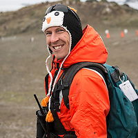 Portrait of Naturalist Zack Brown wearing a penguin hat taken on Barrientos Island in Antarctica.