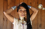 DEMOSO, April 11, 2016 (Xinhua) -- <br /> <br /> A Padaung woman with brass rings around her neck combs her hair at her home in Panpet village, Demoso township, Kayah state, Myanmar, April 11, 2016. The brass rings are first applied when the Padaung girls are about eight years old and as the girl grows older, longer coils are added up to 24 or 25 rings.<br /> ©Exclusivepix Media
