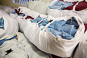 Bundles of prisoners clothes all clean and ready to return to prisoners on the wings.  HMP/YOI Portland, a resettlement prison with a capacity for 530 prisoners. Dorset, United Kingdom.
