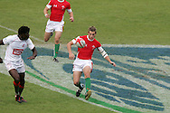 Jason Tovey of Wales chips ahead as they try to get an attack going. IRB Emirates airline Dubai sevens 2008. match 35 action, Bowl semi  final between  Wales and Portugal  at the Sevens Stadium in Dubai on Sat 29th November 2008..pic by Andrew Orchard.