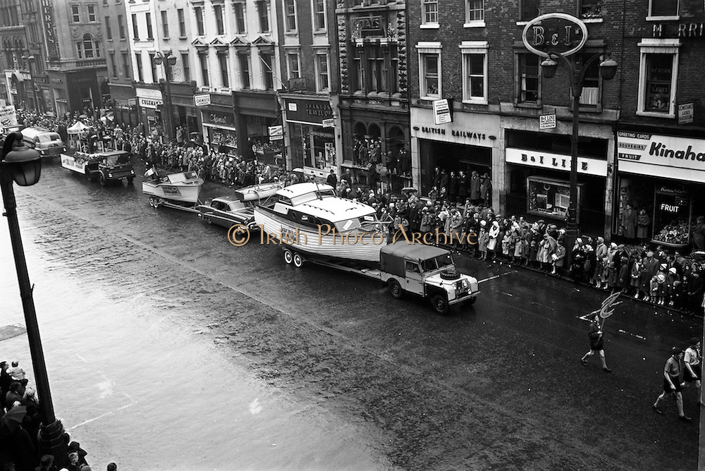 17/03/1964<br /> 03/17/1964<br /> 17 March 1964<br /> St. Patrick's Day Parade, Dublin.  Hickey Boats (Galway) in the parade passing down Westmoreland Street.