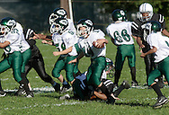 Middletown, NY - A Minisink Valley player carries the ball during anOrange County Youth Football League game against Middletown at Watts Park on Sept. 2, 2007.