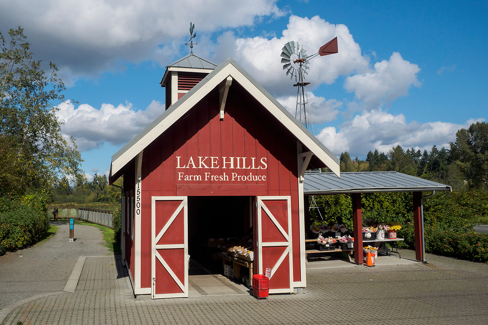 USA, Washington, Bellevue. Produce stand and barn and windmill at Lake Hills Greenbelt Park.