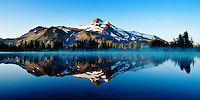 A panoramic view of Mount Jefferson and its reflection in Russell Lake.
