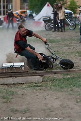 James Pelletier jumping (and crashing) a minibike in the downtown campground set up for the Run to Raton. Raton, NM. USA. Saturday July 21, 2018. Photography ©2018 Michael Lichter.