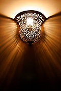 In Moroccan homes or Riads, lights are beautifully set and hand made to set wonderful textures onto walls like this one in Fes, Morocco on Monday evening, May 28, 2007. (PHOTO BY TIMOTHY D. BURDICK)