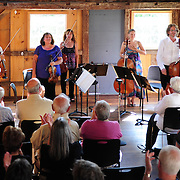 Jaroslaw Lis, Teri Einfeldt, Melinad Daetsch, Katie Kennedy, and Eric Dahli of The Arensky Ensemble take bows after performing in the barn at Moffatt-Ladd House in Portsmouth, NH. July 2012