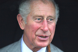 The Prince of Wales smiles during a visit to the island of Tortola in the British Virgin Islands as he continues his tour of hurricane-ravaged Caribbean islands.