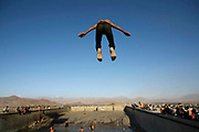 A boy jumps from a concrete diving board into a pool on Bibi Mahro Hill in Wazir Akbar Kahn section in Kabul on one October afternoon. Five years after the fall of the Taliban, children have more freedom to enjoy swimming, exposing their skin in public which was banned during the five-year rule of the one of the most repressive regimes in the world. This swimming pool was said to have been built during the Soviet rule, later used as an execution wall by different warlord factions before Taliban took over the city in 1996.