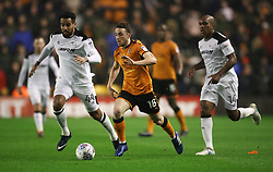 Wolverhampton Wanderers' Diogo Jota breaks from Derby County's Andre Wisdom and Tom Huddlestone (left) during the Sky Bet Championship match at Molineux, Wolverhampton.