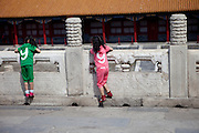 """The two daughters of a Chinese family playing inside  """"The Forbidden City"""" which was the Chinese imperial palace from the Ming Dynasty to the end of the Qing Dynasty. It is located in the middle of Beijing, China. Beijing is the capital of the People's Republic of China and one of the most populous cities in the world with a population of 19,612,368 as of 2010."""