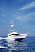 Running 58' American Custom Yacht in calm water.