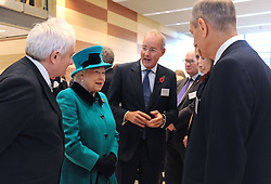 Queen Elizabeth II talks to Cancer Research UK financial donors during a visit to officially open the Francis Crick Institute in central London.