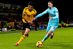 Raul Jimenez of Wolverhampton Wanderers takes on Florian Lejeune of Newcastle United - Mandatory by-line: Robbie Stephenson/JMP - 11/02/2019 - FOOTBALL - Molineux - Wolverhampton, England - Wolverhampton Wanderers v Newcastle United - Premier League