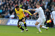 Troy Deeney of Watford (l) is challenged by Alfie Mawson of Swansea city. Premier league match, Swansea city v Watford at the Liberty Stadium in Swansea, South Wales on Saturday 22nd October 2016.<br /> pic by  Andrew Orchard, Andrew Orchard sports photography.