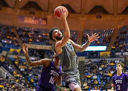 Jan 14, 2020; Morgantown, West Virginia, USA; West Virginia Mountaineers guard Jermaine Haley (10) makes a move around TCU Horned Frogs forward Diante Smith (10) and shoots during the second half at WVU Coliseum. Mandatory Credit: Ben Queen-USA TODAY Sports