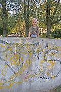 Boy age three having fun climbing on retaining wall. Balucki District Lodz Central Poland