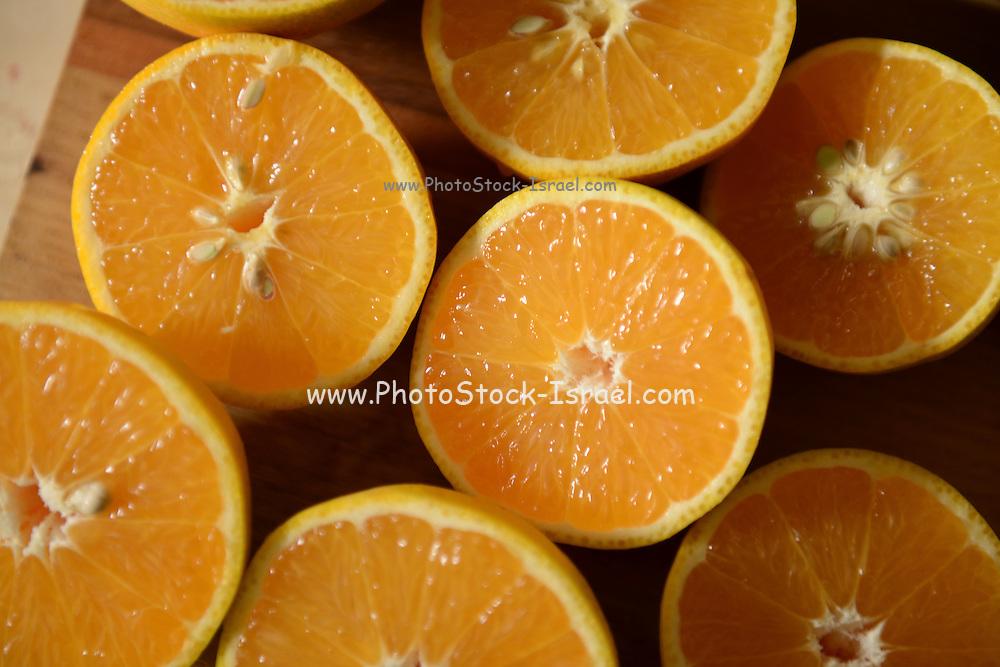 cut oranges on a cutting board