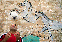 """Rifaat """"Jimmy"""" Tourk, a major soccer star in the 1970s and 1980s is seen in Jaffa, Israel, Feb. 1, 2006. Tourk, an Israeli-Arab, born in Jaffa, played on the national team. Fans and players would yell at Tourk, """"Go play in Lebanon!"""" and """"Your place is not here with us!"""" Current Israeli football star Abbas Suan, an Israeli-Arab, still faces criticism and racism resulting from the unsettled conflict between the Israelis and Palestinians."""