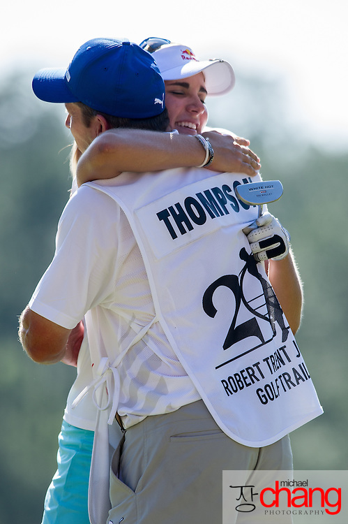 April 29 2012: Lexi Thompson hugs her caddy after finishing with a total score of 16 under par during the final round of the Mobile Bay LPGA Classic at Magnolia Grove in Mobile, AL.